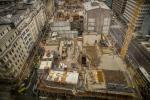 Conçu par Foster + Partners, associé au bureau luxembourgeois Tetra Kayser, le chantier doit aboutir à une livraison des bâtiments de manière échelonnée entre l'été 2018 et la mi-2019.